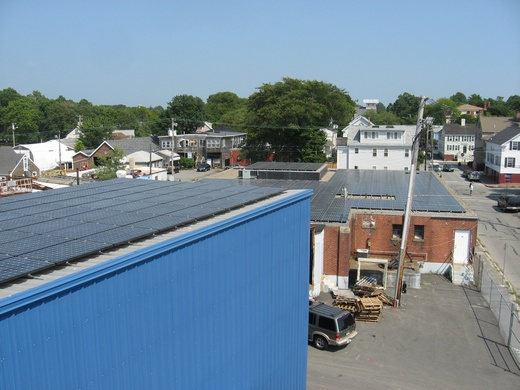 156.555kW system on two roofs, one standing seam metal roof and one gravel roof