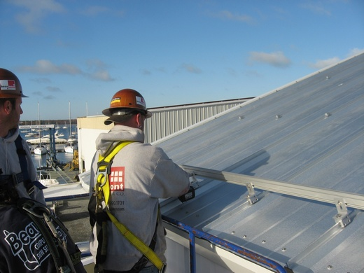 Attachment of solar racking system to metal roof