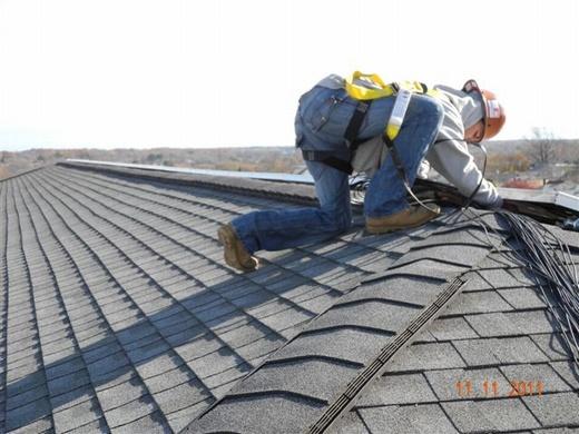Beaumont Solar electrician preparing to run string wiring through conduit