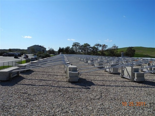 Beaumont Solar engineered and designed this 54.99kW system using a ballasted rail mounting system on the building's gravel roof