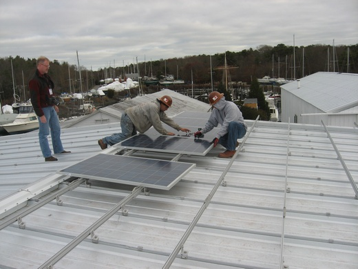 Beaumont Solar in-house installer begin panel attachment on one of three buildings that comprise this 100kW system