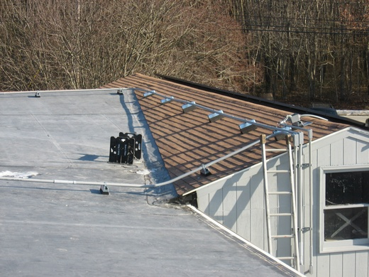 Conduit runs from rooftop array to system inverters