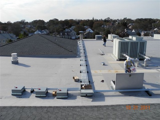 Conduit runs from string combiners will lead down to the 122.20kW system's 100kW inverter