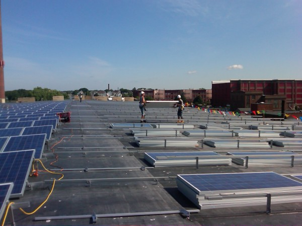 Installation begins on east side of this 50,260sq ft roof