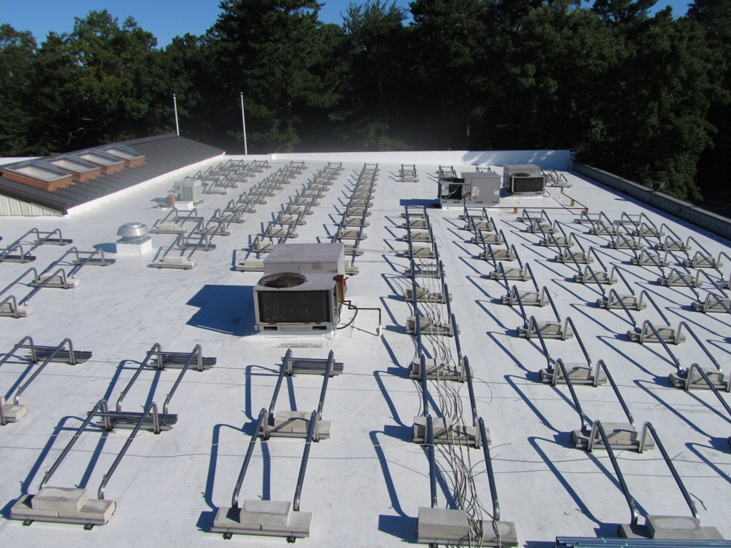 Installation begins with layout of ballast racking system