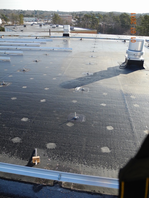 Installation of racking on rubber membrane roof