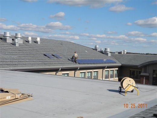 Installation of the system's 520 solar panels begins