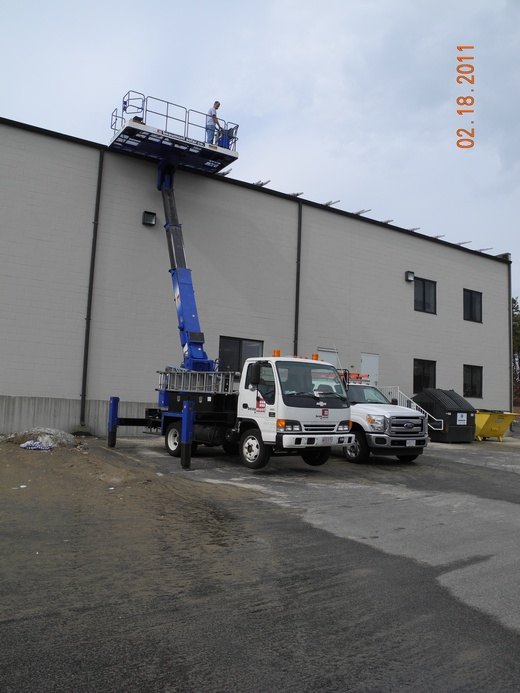 Member of the in-house Beaumont Solar installation team bringing panels to the roof with aichi