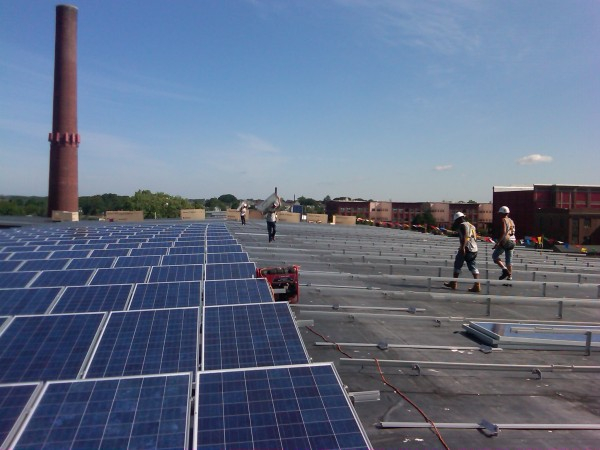 Members of the Beaumont Solar installation team begin installing the panels on the east side of this 50,260sq ft roof