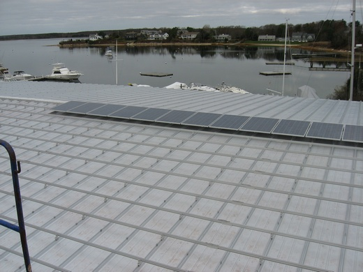 Modules being installed on metal roof