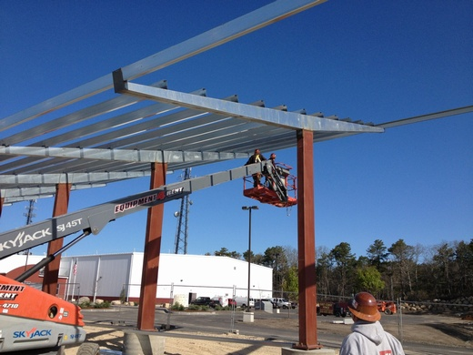 Nearing completion of carport structure's frame