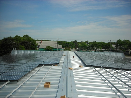 Portion of 183kW system installed on standing seam metal roof