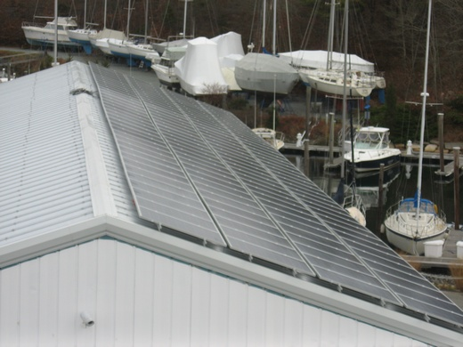 Portion of completed 100kW system spanning three roofs at the Kingman Yacht Center