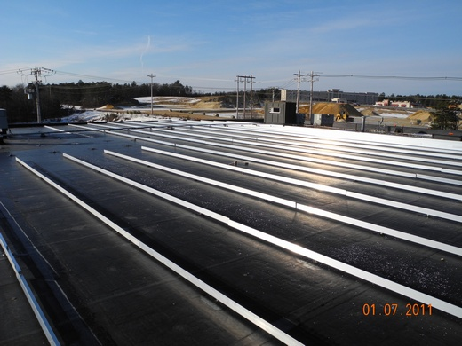 Racking system installed on rubber membrane roof