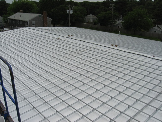 Racking system installed on standing seam metal roof