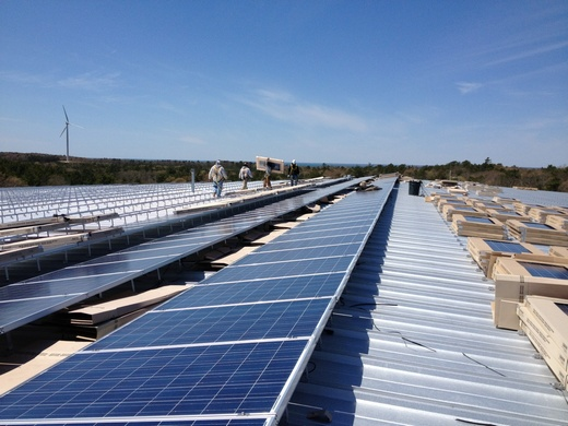 Simultaneous construction on the 377.52kW roof system begins