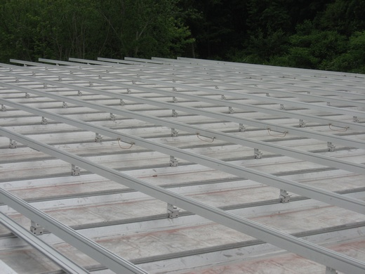 Solar racking system installed on standing seam metal roof