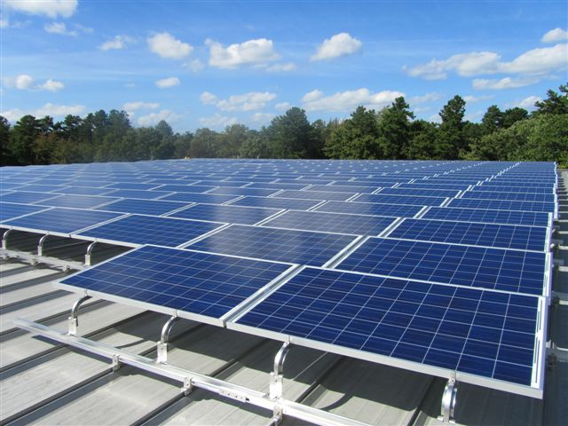 Solar racking system installed on the portion of the roof that is standing seam