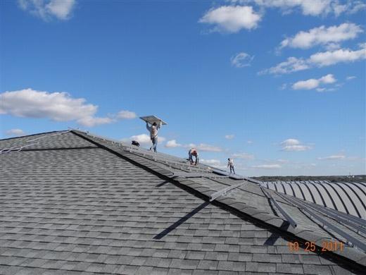 Solar rail system on the school's shingled roof
