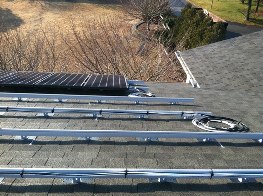 System is installed on asphalt shingled roof