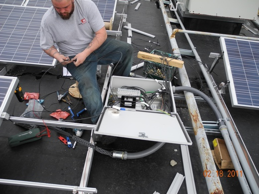 The Beaumont Solar in-house electrical team wires panel strings to combiner boxes