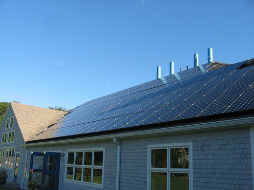 The two building's arrays total 77kW, combine to a solar load center and utilize one Satcon 75kW inverter