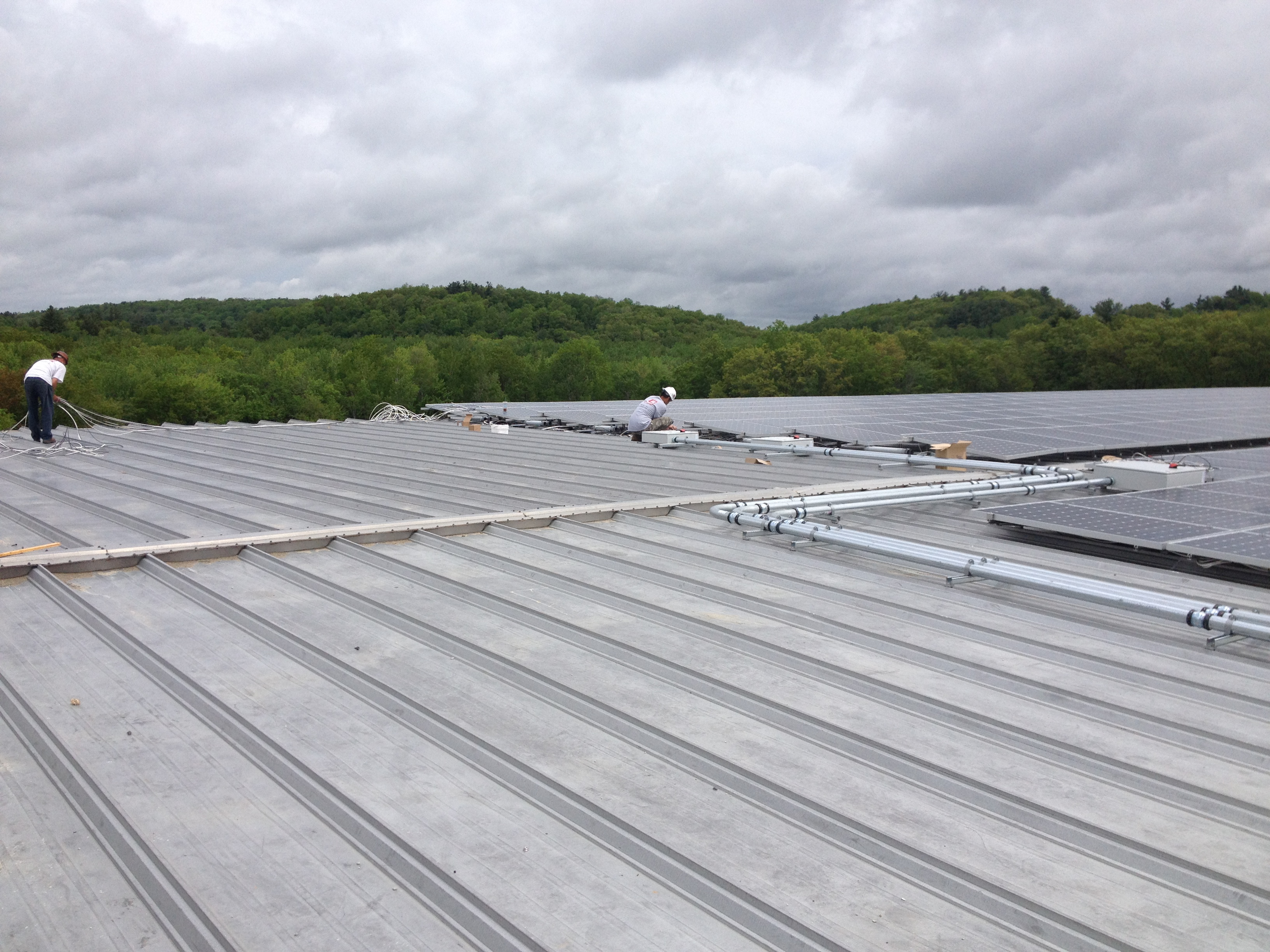 John previewing the wires on the standing seam metal roof