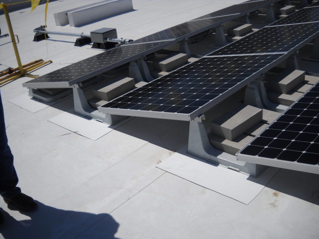 The Beaumont Solar design team designed this system with a non-penetrating ballasted racking system.