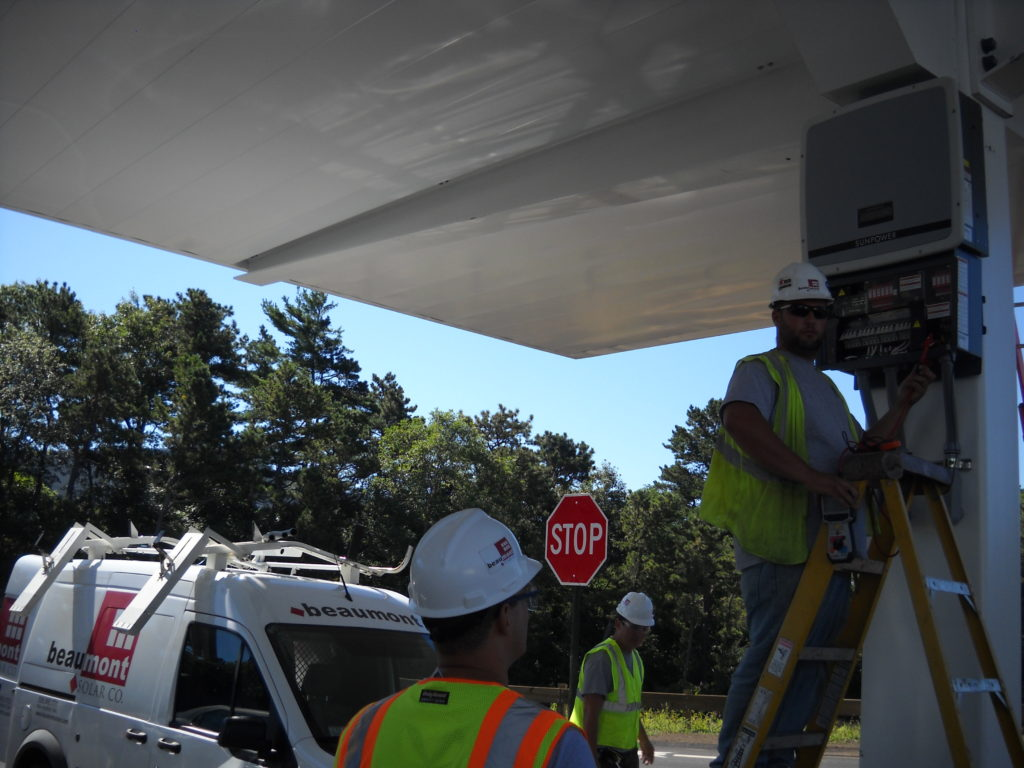 The carport inverters are mounted under the carport array.