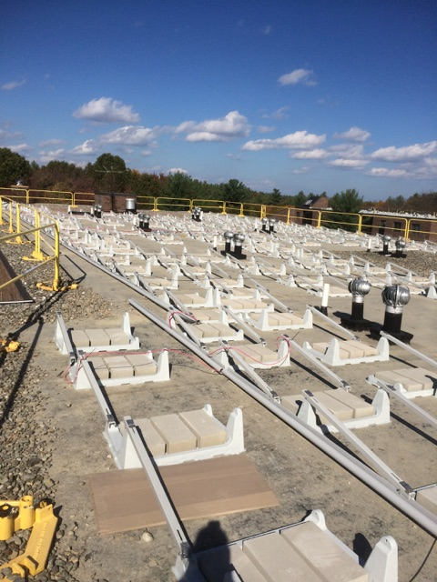 This system utilizes a non-penetrating ballasted solar mounting system