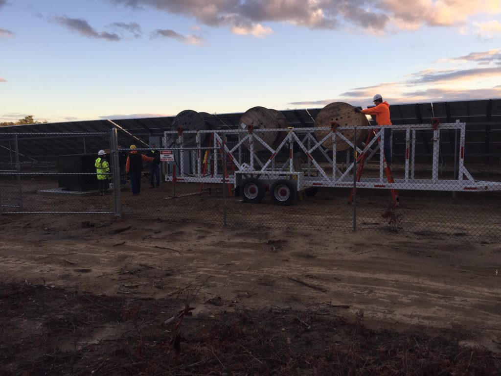 The sun sets on the Beaumont Solar electricians pulling the medium voltage wire that will connect the solar system to the utility grid
