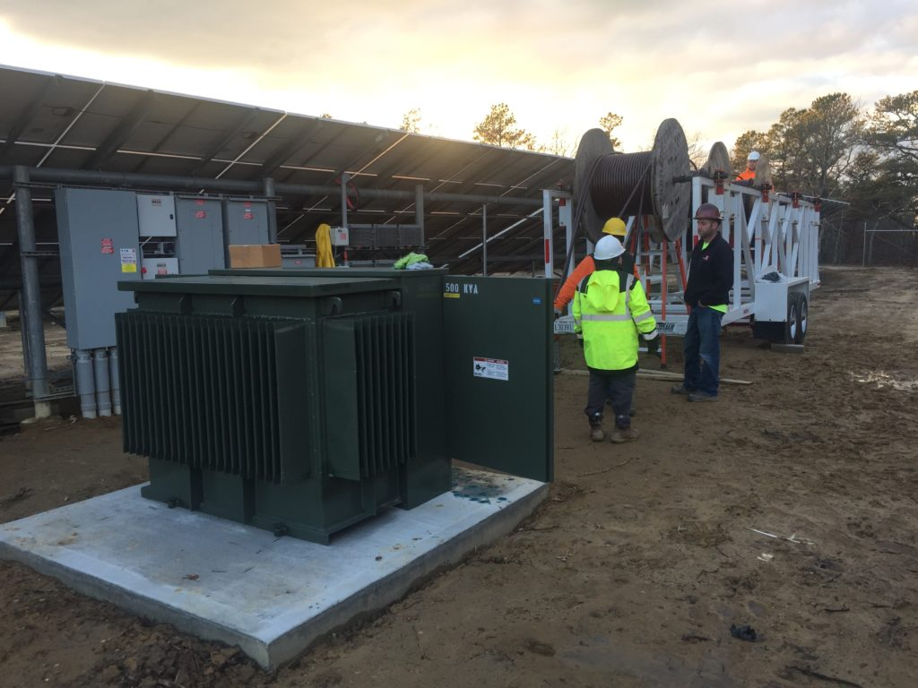 The new 500kVA is in place.  Medium voltage wire is pulled through the transformer to the interconnection point 2000ft to the street