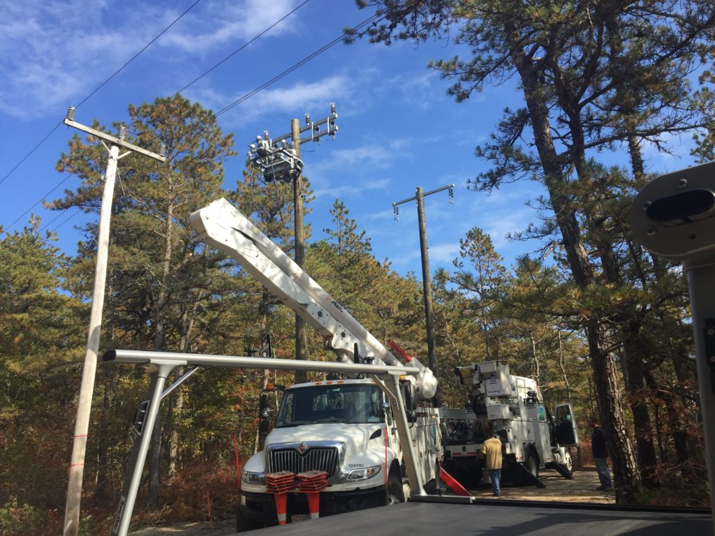 Eversource utility crews come to install the new pole where Beaumont Solar electricians will tie the solar system into the grid