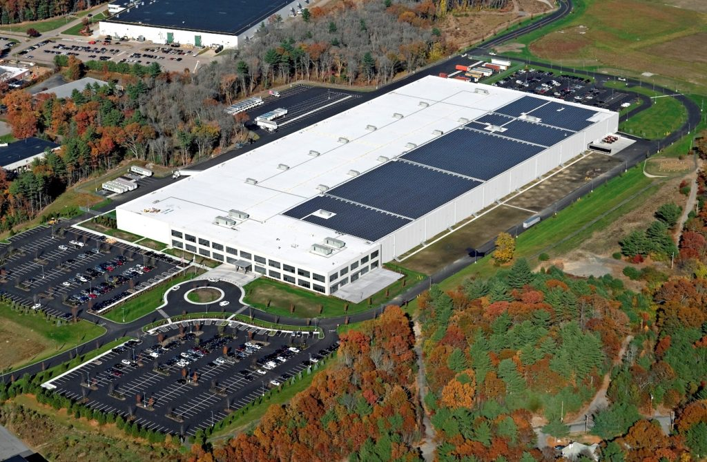 Aerial view of the 2.2MW DC rooftop system on the newly constructed LEED Certified facility of Martignetti Companies in the Taunton Industrial Park