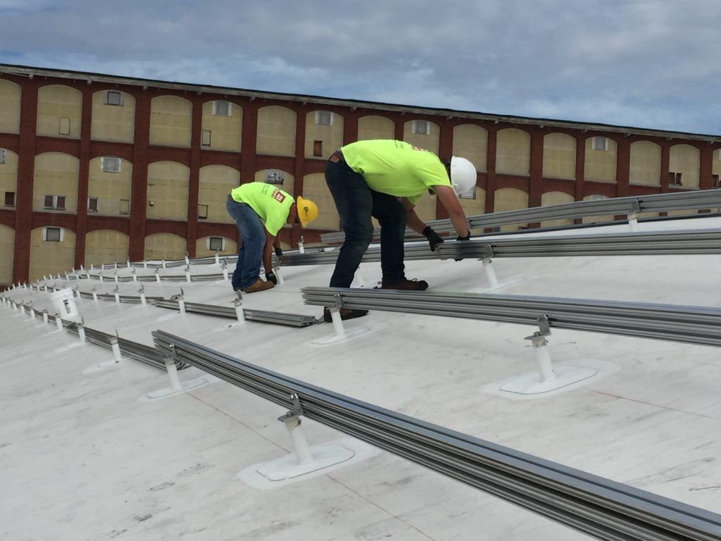Our crew during installation of the rails that the solar panels will be fastened to.