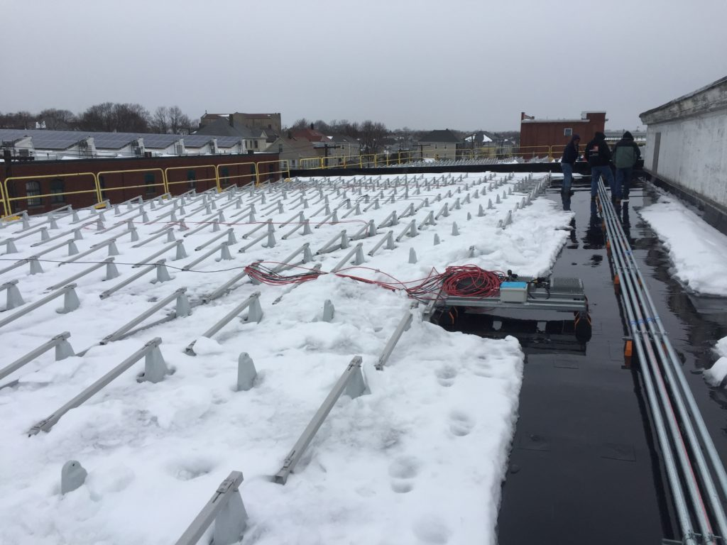 As happens in New England, a little snow fell overnight, so the crew moves onto pipe and wire work to keep the job going.