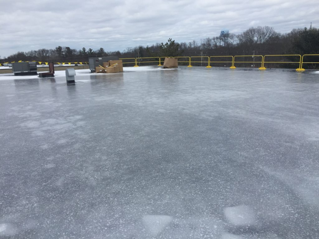Safety rails are up and we're ready to go.  But Mother Nature decided to turn the roof into a skating rink overnight so we'll let the sun thaw things out.