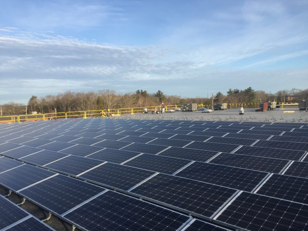 This 131kW DC solar system for Baynes Electric Supply Co provides power to the building and net meters excess power to other National Grid offtaker accounts.