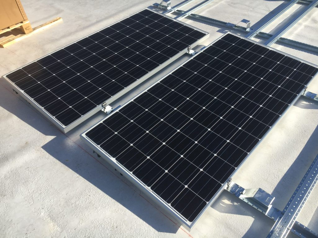 Close-up view of panels attached to the rails of the solar racking system.