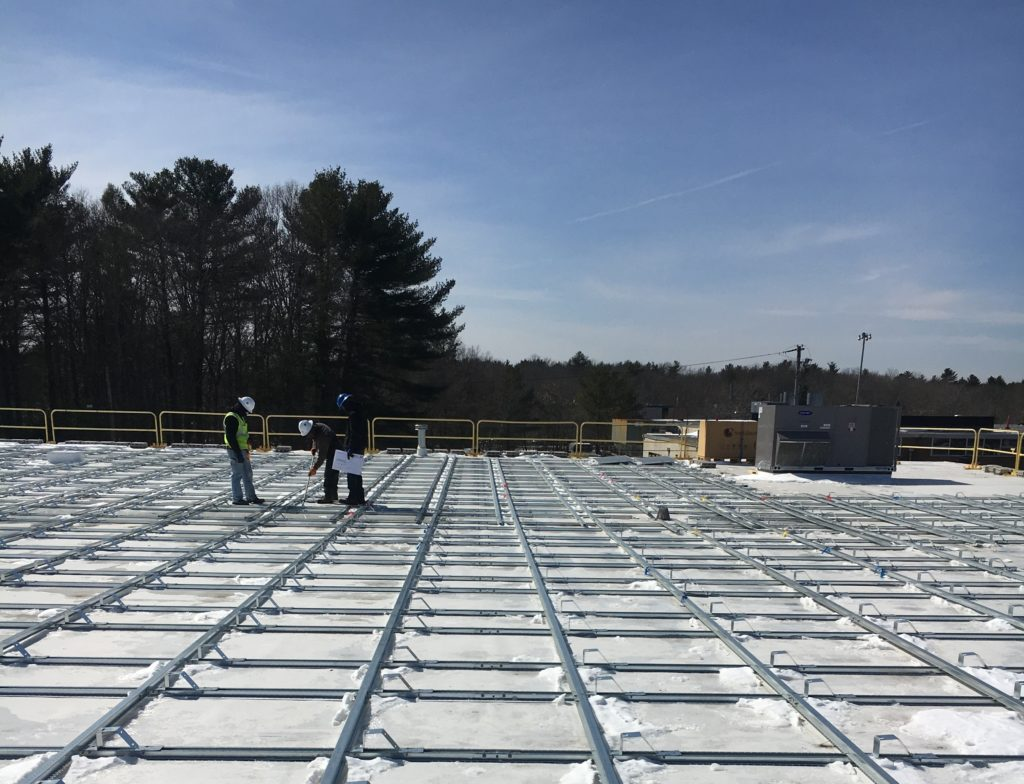 Before any solar panels are installed, our project managers inspect the racking installation one more time to ensure it conforms to our engineering team's designs