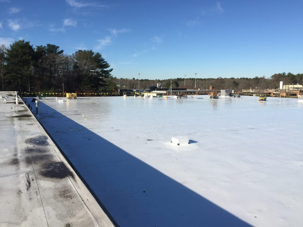 View of the white TPO roof.  The Beaumont Solar electrical installation team begins to stage equipment on the roof to begin the installation of this 403kW DC solar rooftop system.