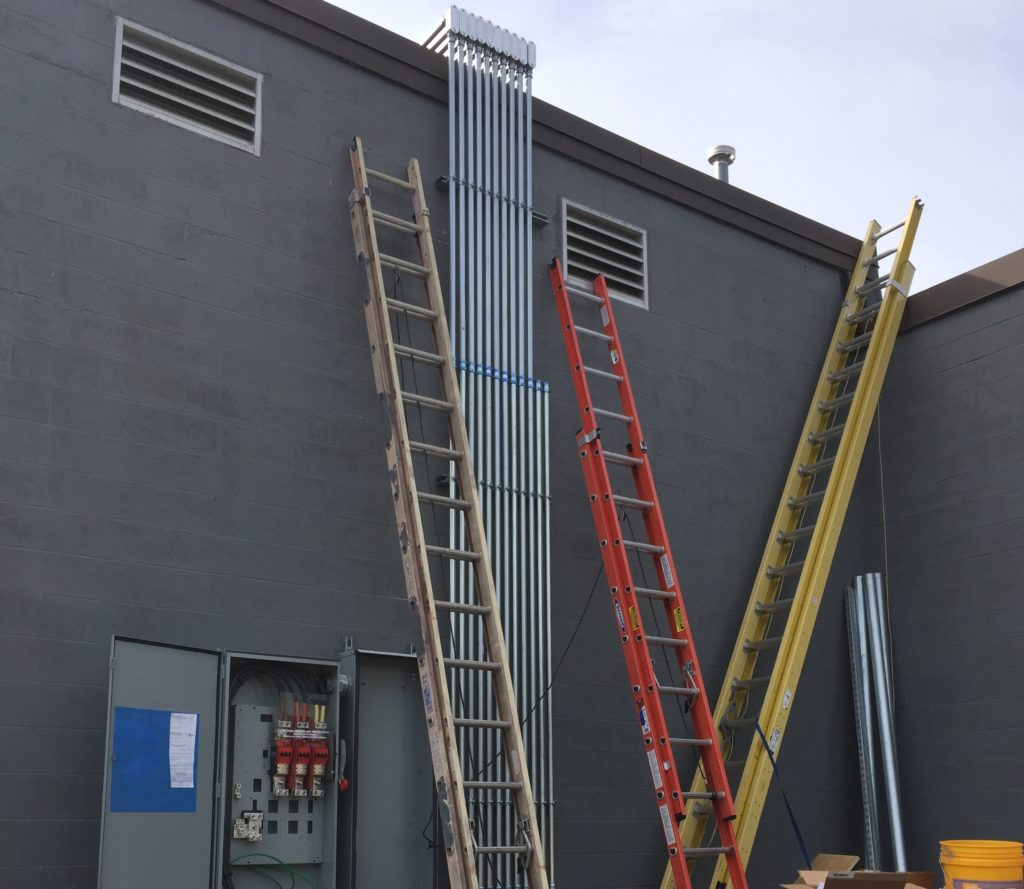 Our highly trained electrical team takes great pride in ensuring the asthetics of a customer's building.  Here you can see how they used precision in bring the AC wiring piping down from the roof in almost a waterfall-like sculpture.